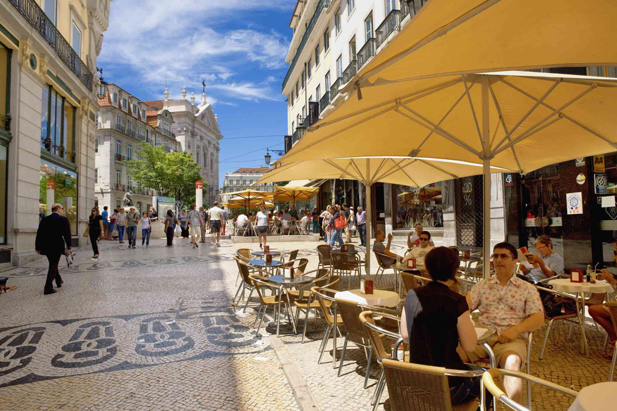 Moving to Portugal from France cafe in Lisbon calcada stone pavement